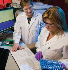 Analytical chemists (from left) Carolyn Koester and Heather Mulcahy work in an environmental reference laboratory at the Forensic Science Center to develop and validate sensitive methods for analyzing chemical warfare agents.