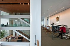Less space per worker may be inevitable for cost-effectiveness, but it can also enhance the working environment. The favorite working space of Martha Choe, the foundation's chief administrative officer, is a long, narrow table in the building's vast atrium.