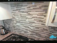 Stone/tile/glass backsplash for a neutral gray kitchen