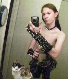 goth punk kid posing with cats bad self portraits bad Family Portraits Bad Family Photos Ellen worst family pics funny pictures awkward family photos wtf ugly people stupid people crazy people weird people