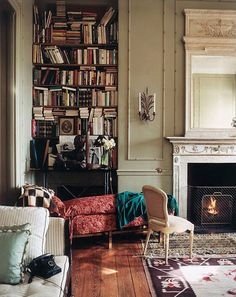 great reading nook  books + moldings + fireplace + grey-green paint