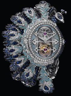 Girard Perregaux HERA TOURBILLON Watch - with 271 diamonds, 868 blue sapphires, 426 purple sapphires, 310 Paraiba tourmalines, one blue cabochon sapphire, and three gold Bridges Tourbillon. Price: Just under $1 million