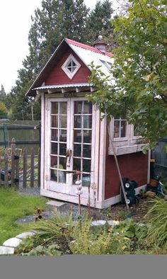 tiny garden shed would double as green house ... love the window boxes, too. (photo only)