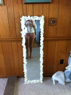 flower mirror project- Buy one of the cheap looking full body mirrors and hot glue flowers around it! _bry's room!