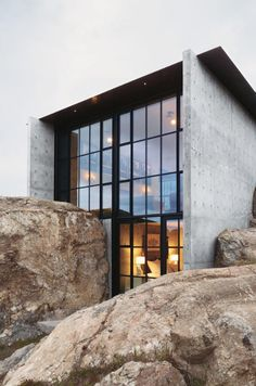 House built into the rocks, glass walls