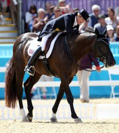 Tina Konyot of Palm City, Florida, pats down her horse Calecto V Friday, Aug. 3, 2012 after they finished competing in the dressage team competiton at the 2012 Olympic Games in London.