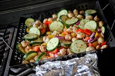 "my summer ""specialty"": chop up yellow and red peppers, mushrooms, red onion and zuchinni; coat with olive oil; sprinkle with garlic salt, ground pepper, basil and oregano (or whatever you like). grill in a grilling basket. the end."