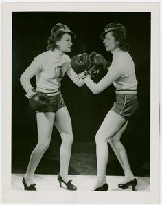 Women boxing in heels.