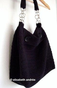 black shoulder bag with metal rings