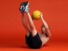 Weighted V sit-ups    Sit on the ground, holding a weight plate or a medicine ball to your chest. Raise your feet so that the only part of your body touching the ground is your backside.