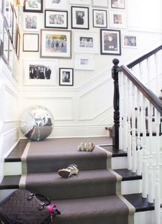 great art + a disco ball, decor, gray runner, stairs, waitnscoting, white risers, entrance, entrance hall, entry, entryway, entry way, foyer, front hall, front door, hall, hallway, home, interior design, Love the stairs #interiors, mudroom, mud room, stairwell, staircase, stair runner, stairs, stair hall