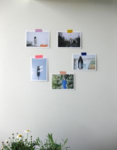 Photos on the wall with colorful tapes