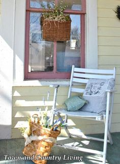 This chair is cute, but what's on the other side of the porch is simply adorable