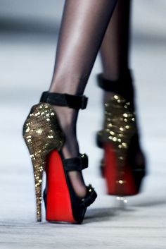 louboutins. I remember I saw a photo of these once saying a woman should keep their heads, heels, and standards high!
