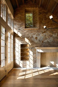 Salvaged materials aren't just for the exterior.  In the case of Hidden Manor, the salvaged Chicago brick was brought inside.  And what's the point of using brick and stone if you can't express their solidity and massiveness?  A simple splaying of the window's rough opening does just that.