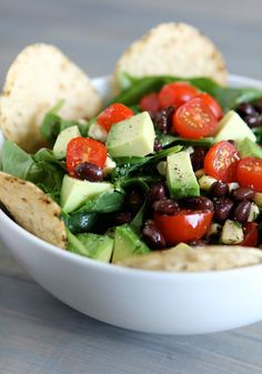 Mexican Spinach Salad      ■4 cups fresh baby spinach  ■1 cup cherry or grape tomatoes, halved  ■1 cup avocado, diced  ■1 cup fresh or canned corn [or sweet corn & lime salad]  ■1 cup black beans, canned – drained & rinsed  ■1/3 cup cilantro, chopped  ■salt + fresh black pepper  ■Optional: corn tortilla chips  For protein -  add grilled chicken