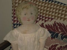 C1900 Doll with Printed Face.....Lovely expression....Wearing a white dress with eyelet trim......................