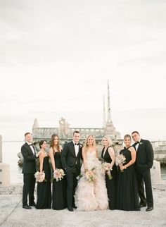 Bridal party in black, bride in blush pink!