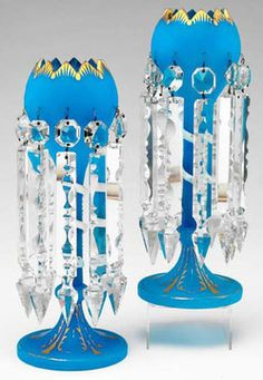 "lighting, England, A pair of English Royal Blue Bristol and opaque white glass lustres, the stems of the parcel-.gilt frosted Royal-blue coupes wwntwined by parcel-gilt opaque white serpents, each dressed with magnum back-cut ""Albert"" spears. Circa 1876-1900"