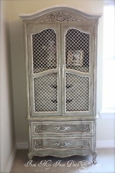 DIY: French armoire painted with Chateau Gray and Old White Chalk Paint and finished with both clear and dark waxes to add definition.