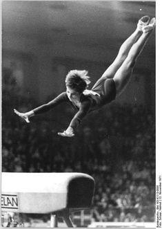 Gymnast Angelika Hellmann performing on vault exercise (1971).