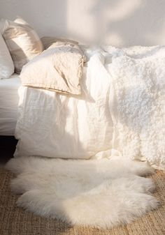 """You probably never even noticed a spa's greatest trick for creating a calming environment: """"Soft fabrics, like mohair, help keep sounds from echoing,"""" says Stacy Shoemaker, editor-in-chief of Hospitality Design, which recognizes the world's top hotels with its annual design awards. White sheepskin throws, rugs and covered pillows are especially popular right now. We found one starting at about $30 a piece."""