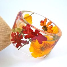 Zinnia and Cosmos Botanical Resin Bangle.  by SpottedDogAsheville, $49.00