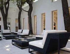 Chanel- Peter Marino. Beautiful. Yep  I can reproduce this made from old pallets and some chic cushions..