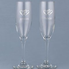 Heart Themed Toasting Flutes (Set of Two)  Simple but elegant, these toasting flutes are a great choice for any style of wedding.  http://www.favorfavor.com/page/FF/PROD/HBH52107