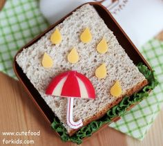 Kid's Lunch: An apple, cheese raindrops and a sandwich. Easy and cute