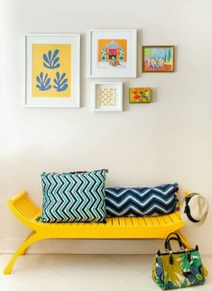 Yellow bench, blue accents in an entrance.