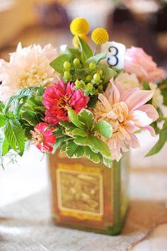 great spring centerpiece, photo by Jennica Jo http://ruffledblog.com/vintage-pink-estate-wedding #flowers #centerpieces #weddingideas