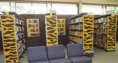 Put a pattern to go with theme on sides of bookshelves.  Interesting!