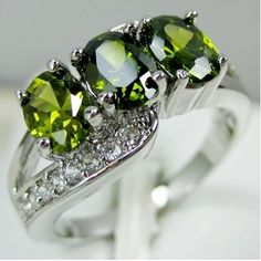 'Size 7, 8, 9 4CT Lab Green Peridot 10K GF Ring' is going up for auction at  9am Fri, Jan 11 with a starting bid of $1.