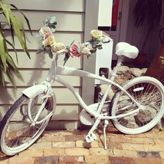 This actually reminds me that i need to pump up my bike's wheels and go biking.... pretty bike tho (lurv the roses ^.^ )
