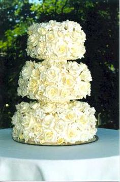 Wedding Cake = Covered in Wild Flowers