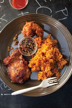 Marinated with the traditional Guam-style sauce finadene, a blend of cane vinegar, soy sauce, and aromatics, this succulent grilled chicken is served with annatto-tinged red rice at the food cart PDX 671 in Portland, Oregon.