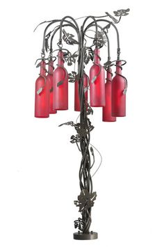 Wine bottle floor lamp,Lose the leaves make the bottles clear, use copper tubing for frame.