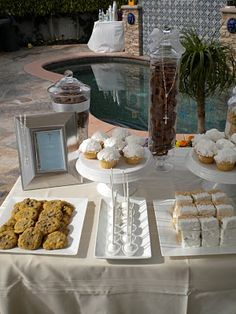 Pretty white dessert tray with sweets to be used as favors.