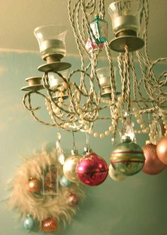 Simplest christmas chandelier. I did something similar to this with a beaded garland from the Dollar tree and used string to hang ornaments from the garland. I should also mention the ornaments are from the same store. Frugal's my middle name.