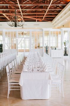 Long white reception tables | Punta Cana Dominican Republic Tropical Destination Beach Wedding | Photograph by Michael Rousseau Photography http://storyboardwedding.com/punta-cana-dominican-republic-tropical-destination-beach-wedding/