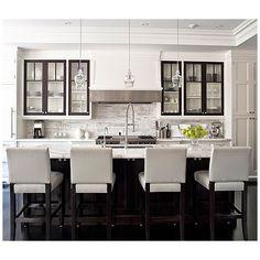 kitchens - white leather stools espresso kitchen island marble countertops marble tiles backsplash polished chrome faucet glass pendants white kitchen cabinets found on Polyvore