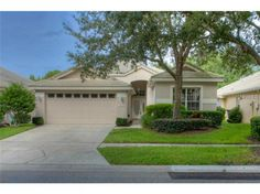 Located in the much sought after, charming, and gated enclave of Nathans Court in Hunters Green.   Lawn service is included in Nathans Court for easy care living.   A well designed 2,004 square foot home complete with screened in pool.  This floor plan provides living room and dining room, plus a family room off the kitchen. The master bedroom has 2 walk in closets, and the master bath boasts a garden tub, separate shower, and dual vanities.   In the kitchen you'll find a Whirlpool ...