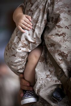 Hold them close while you can (U.S. Marine Corps photo by Cpl. Reece Lodder)