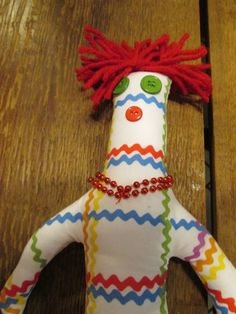 Ric Rac Print Dammit Doll. Poem attached: When life has hit you by surprise, And things aren't going your way. Here's a word from the wise, Dammit Doll can help your day.  Take Dammit Doll by the legs, beat it black & blue shouting - - - Dammit, Dammit, Dammit! by tobeesgifts on Etsy, $18.95.