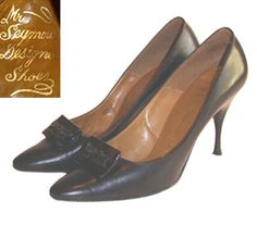 50s pointed toe, black leather designer shoes. High heel pumps have stitching on top line and vamp has a brown tortoise shell