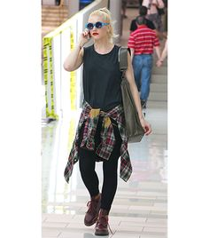 Gwen Stefani gives 21 Jump Street's Johnny Depp a run for his money in her black muscle tank, a plaid shirt tied around the waist, and Dr. Martens.