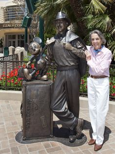 Diane Disney Miller with the DCA statue of her dad.