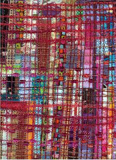 Made from leftover strips of quilt fabric, stitched with built in patterns and couched with yarns. Made by Linda Stokes