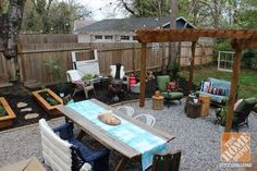 Backyard Makeover: A sitting area, a fire pit, a dining area, and a buffet/bar area-- all make for a great place for relaxing or outdoor entertaining.